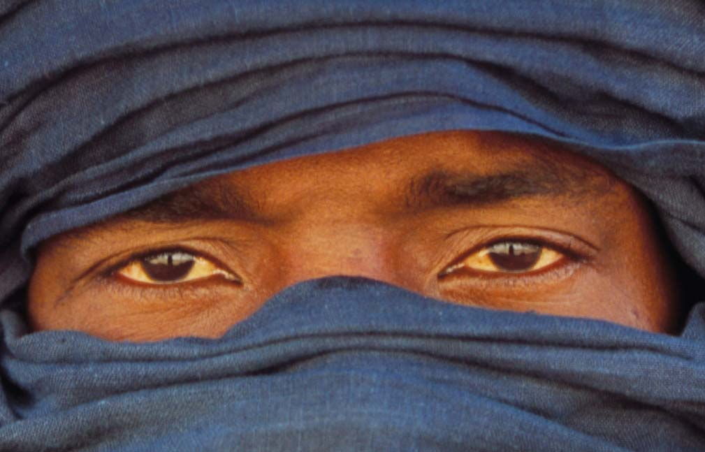 The face of a Libyan Tuareg in a blue veil leaving only his eyes uncovered.